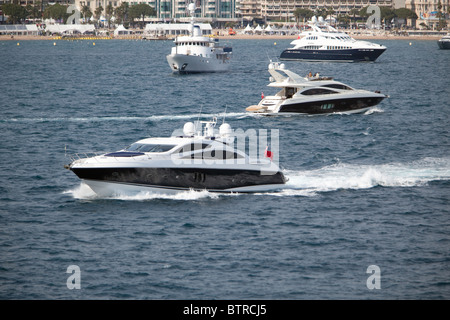 A plethora of private and charter yachts attending Cannes Film Festival France. - Stock Photo