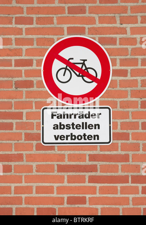 No bicycles sign, Fahrrader abstellen verboten, Bicycle parking Prohibition sign on brick wall - Stock Photo