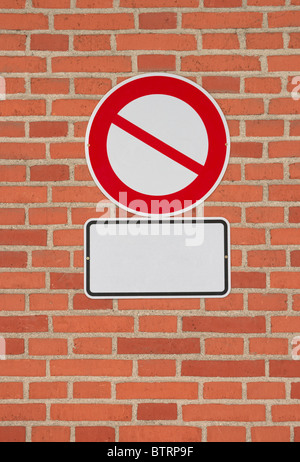 Prohibition sign with blank letter plate on brick wall. Template to put any icon and text on. - Stock Photo