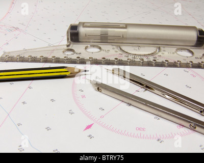 Navigation tools lie on the sea chart - Stock Photo