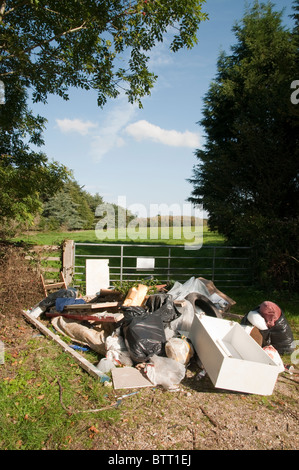 Fly Tipping at Exbury in the New Forest National Park - Stock Photo