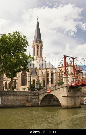 Church and footbridge Saint Georges, Lyon, France - Stock Photo
