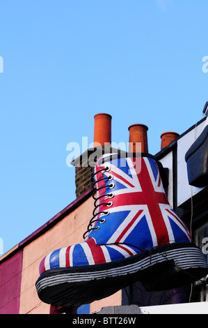 A Giant Union Jack Dr Martens Boot above a shop in Camden High Street, London, England, UK - Stock Photo