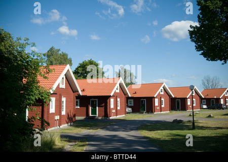 Traditional red falun swedish house summer home houses for Summer homes builder