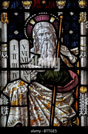 A stained glass window depicting Moses holding the tablets with the Ten Commandments, Heytesbury Church, Warminster, - Stock Photo