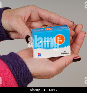 Tramadol drug packet being held in a female patients hand - Stock Photo