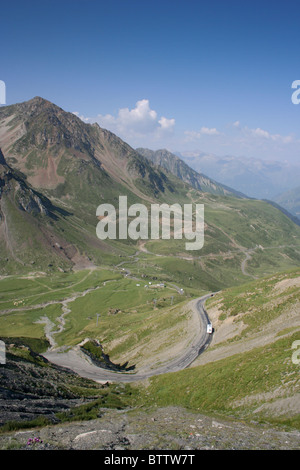 View from the Col du Tourmalet towards Luz-Saint-Sauveur in summer - Stock Photo