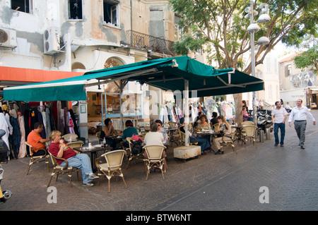 Israel, Tel Aviv, People in an outdoor Cafe in Nachlat Binyamin Street - Stock Photo