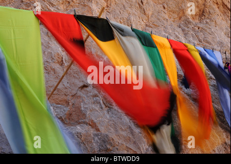 Brightly colored scarves for sale in the Todra Gorge, Southern Morocco. - Stock Photo
