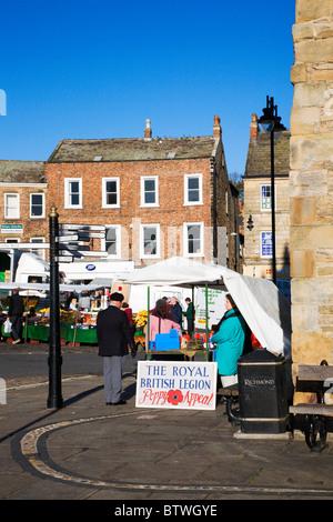 Royal British Legion Poppy Sellers at the Market Richmond North Yorkshire England - Stock Photo