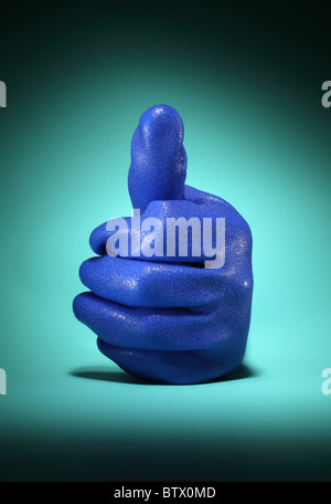 A large blue industrial work glove. Hand in showing a thumbs up position. - Stock Photo