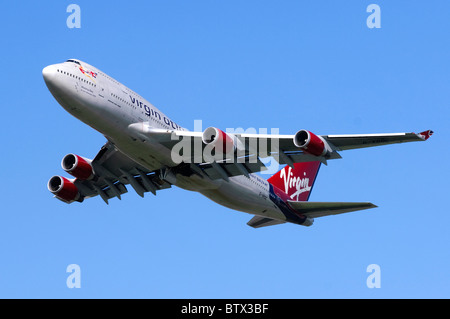 Boeing 747 Jumbo jet operated by Virgin Atlantic climbing out after taking off  from London Heathrow Airport - Stock Photo