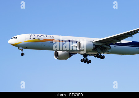Boeing 777 operated by Jet Airways on approach for landing at London Heathrow Airport - Stock Photo