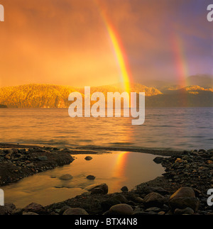 Rainbow over Teletskoye Lake. The Altai Mountains, Siberia, Russia - Stock Photo