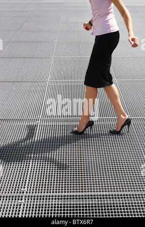 side view of business woman balancing on high heels. Copy space - Stock Photo
