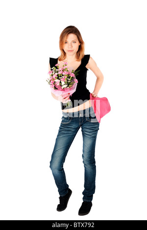 Young attractive woman in relaxed pose carnation flowers and pink hat isolated over white background - Stock Photo