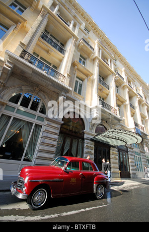 ISTANBUL, TURKEY. The Pera Palas Hotel in Beyoglu district, with the hotel's classic Plymouth parked outside. Autumn - Stock Photo