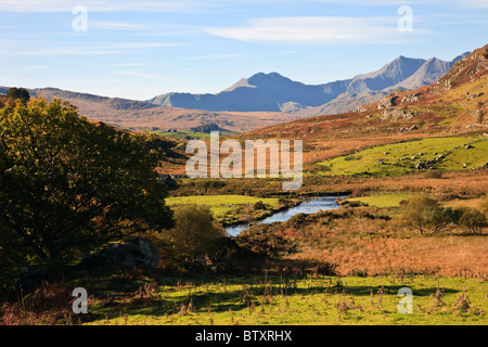 View along Nantygwryd and Afon Llugwy River to Mount Snowdon Horseshoe in Snowdonia National Park in autumn. Capel - Stock Photo