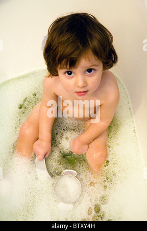 22 month baby boy playing in bubble bath - Stock Photo