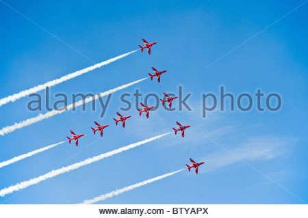 Red Arrows flying in formation, at Farnborough airshow 2010 - Stock Photo