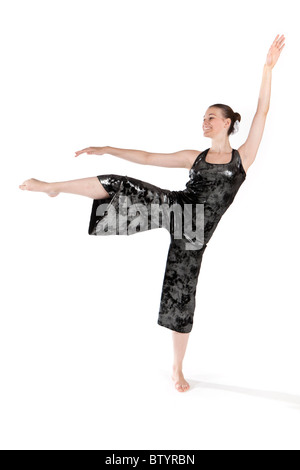 Studio shot of beautiful young girl in modern dancing costume - Stock Photo