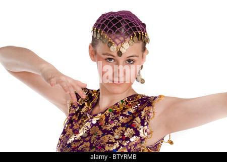 Studio shot of beautiful young girl in Turkish dancing costume - Stock Photo