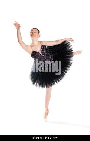 Studio shot of beautiful young ballet dancer in tutu - Stock Photo