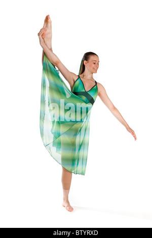 Studio shot of beautiful young girl in lyrical dancing costume - Stock Photo