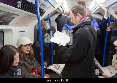 London Underground Victoria Line Train during evening rush hour. - Stock Photo
