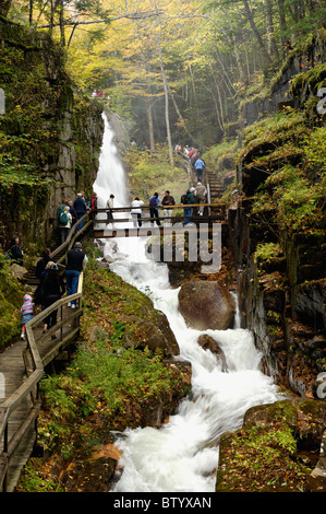 Tourists Walking through the Flume Gorge in Franconia Notch State Park in Grafton County, New Hampshire - Stock Photo