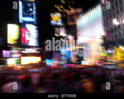 Blurring lights of New York City, Times Square. - Stock Photo