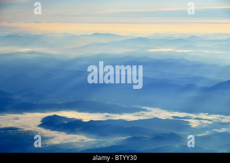 Shafts of sunlight breaking through the atmosphere on an early morning over western Japan, Yamaguchi prefecture, - Stock Photo
