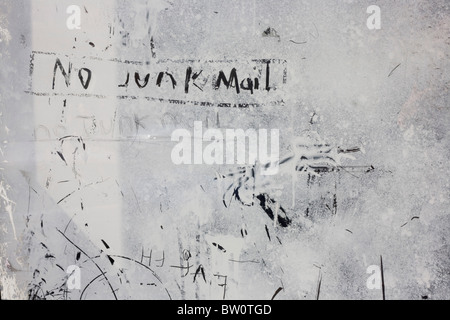 No Junk Mail is scratched into emulsion paint smeared over window of a Healthcare Agency in Brockley Rise. - Stock Photo