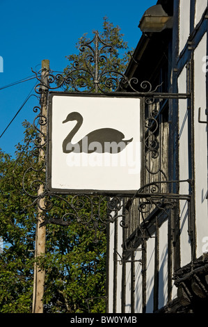 Hanging sign outside the Black Swan pub Peasholme Green York North Yorkshire England UK United Kingdom GB Great - Stock Photo