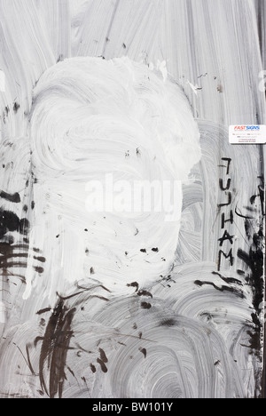 White emulsion paint has been smeared over a shop window on the Fulham Road, a victim of the UK recession. - Stock Photo
