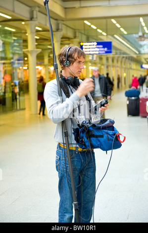 London St Pancras Station sound engineer young man prepares for shoot of a TV program to Ask the Doctor from the - Stock Photo