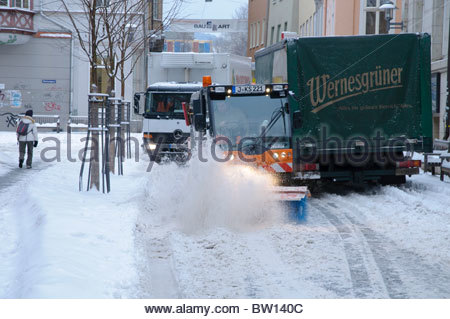 Snowplow clearing a road after low Daisy, winter services, Jena, Thuringia, Germany, Europe - Stock Photo