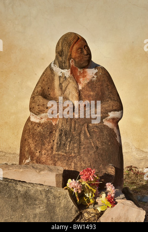 Statue at entrance to church at Mission San Juan Capistrano in San Antonio, Texas, USA - Stock Photo