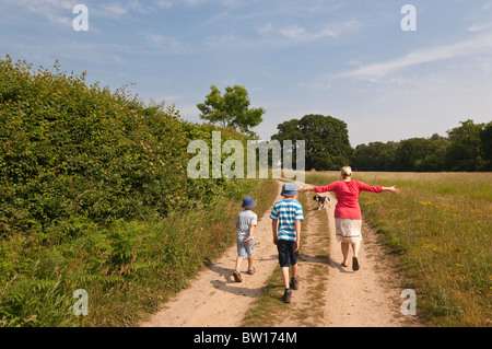 A MODEL RELEASED family on a countryside walk in Benacre , Suffolk , England , Great Britain , Uk - Stock Photo