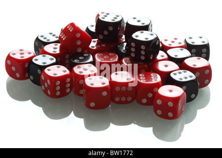 Several black and white dice on a white miror background. Shallow DOF. - Stock Photo
