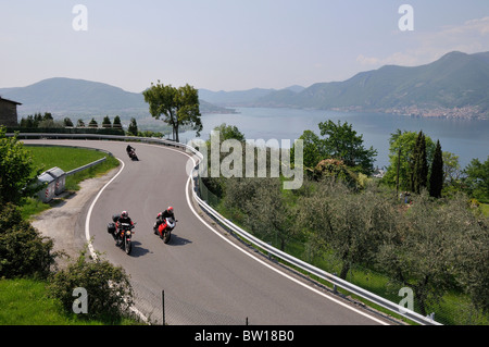 Motorcyclists at Lago d Iseo, Brescia, Italy - Stock Photo
