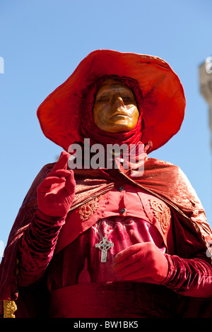 Close-up of a street entertainer mimicking a statue in the Place du Palais in Avignon, France. - Stock Photo