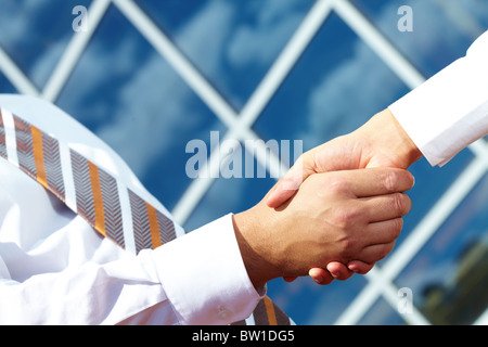 Image of handshaking of business partners outdoors - Stock Photo