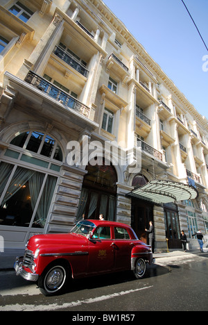 ISTANBUL, TURKEY. The renovated Pera Palas Hotel in Beyoglu, with the hotel's classic Plymouth parked outside. 2010. - Stock Photo