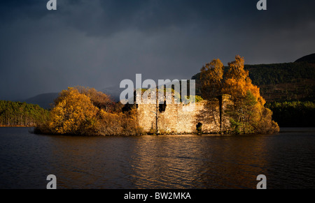 The island and castle on Loch an Eilein Cairngorms National Park  in Autumn - Stock Photo