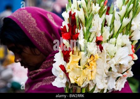 Early morning scene at the colorful flower market near Howrah bridge in Kolkata. - Stock Photo