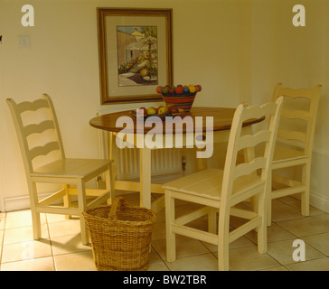cream painted wooden chairs and table in cream cottage dining room