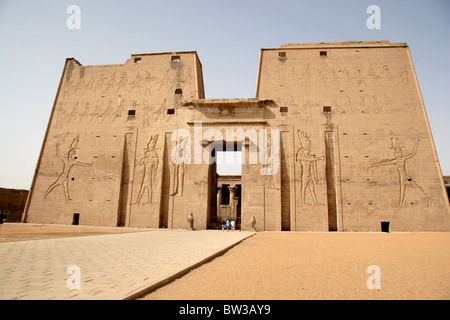 Main entrance to the Ptolemaic Temple of Horus in the ancient Egyptian city of Edfu - Stock Photo