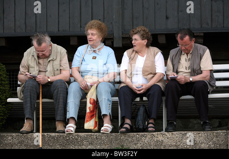 Seniors sitting on a bench, Dresden, Germany - Stock Photo