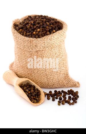 Black pepper in burlap sack - Stock Photo